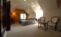 Ramat Niseko Spacious Bedroom with Seating Area | East Hirafu
