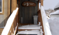 Shirayuki Lodge Entrance Up Stairs with Snow | East Hirafu