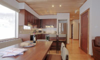 Shirayuki Lodge Kitchen and Dining Area with Wooden Floor | East Hirafu