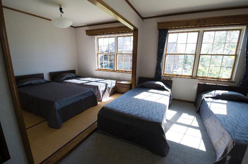 Snowgum Lodge Bedroom with Quad Beds | East Hirafu