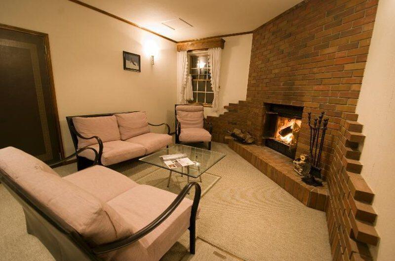 Snowgum Lodge Seating Area near Fireplace | East Hirafu