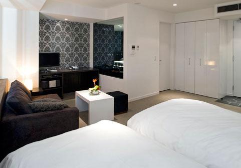 The Vale Niseko Twin Bedroom with Sofa and TV | Upper Hirafu