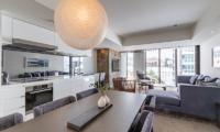 The Vale Niseko Two Bedroom Resort Deluxe Living, Kitchen and Dining Area | Upper Hirafu
