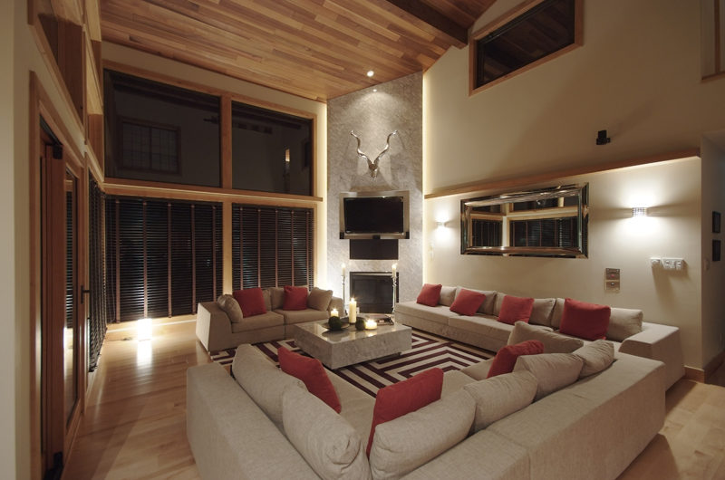 Zekkei Living Area at Night with TV | Lower Hirafu