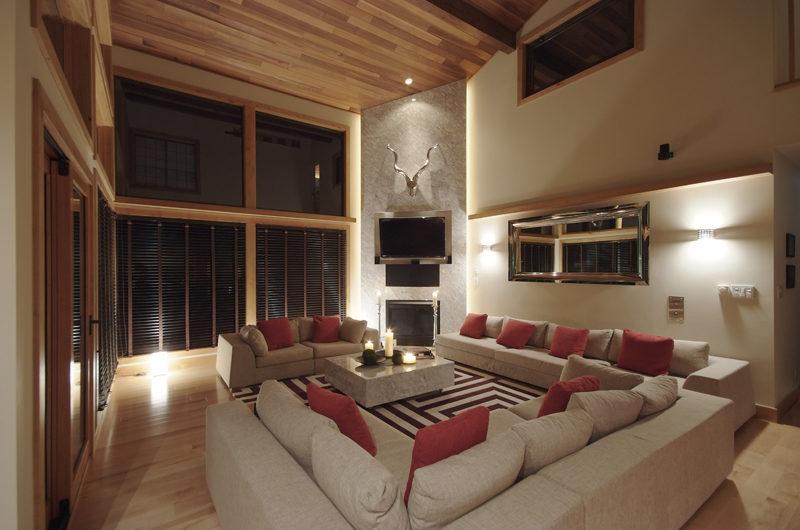Zekkei Living Area at Night with TV | Lower Hirafu