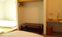 Alpine Central Bedroom with Twin Beds and Study Table | Izumikyo 2