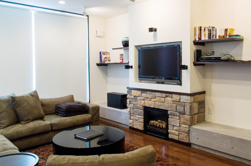 Big Valley TV Room with Fireplace | Lower Hirafu