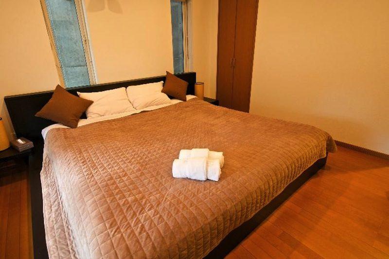 Hurry Slowly Condominiums Bedroom with Wooden Floor | Lower Hirafu