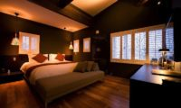Kimamaya Boutique Hotel Bedroom with Wooden Floor | Middle Hirafu Village