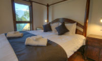 Mangetsu Lodge Bedroom with Four Poster Bed | East Hirafu