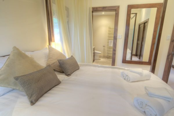 Shika King Size Bed and Bathroom | East Hirafu