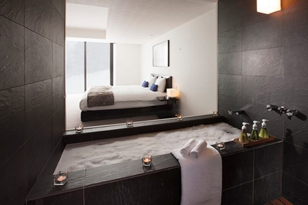 The Vale Niseko Bedroom and Bathroom with Bath Amenities | Upper Hirafu