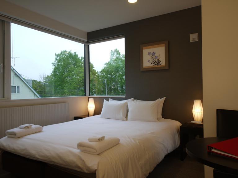Horizon Townhouses Bedroom with Outdoor View   Lower Hirafu