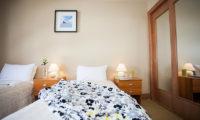 Niseko Alpine Apartments Twin Bedroom with Table Lamps | Upper Hirafu Village