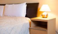 Niseko Alpine Apartments Bedroom with Table Lamp | Upper Hirafu Village