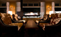 Green Leaf Niseko Village Tomioka White lobby lounge with Fireplace | Niseko Village