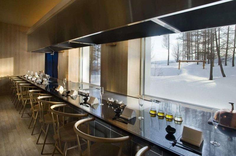 Hilton Niseko Village Dining Area with Outdoor View | Niseko Village