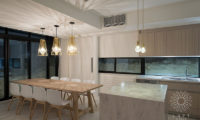 Loft Niseko Kitchen and Dining Area at Night | Middle Hirafu