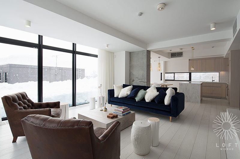 Loft Niseko Living Area with Outdoor View | Middle Hirafu