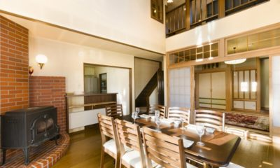 Powderhound Lodge Dining Area Near Fireplace | Upper Hirafu