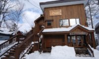 The Lodge Outdoor Area with Snow | Upper Hirafu