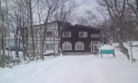 Annupuri Oasis Lodge Entrance with Snow | Annupuri