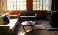 Annupuri Oasis Lodge Lounge Area with Fireplace | Annupuri