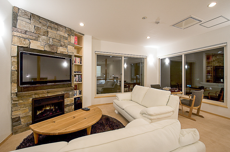 Birch Grove Living Area with TV and Fireplace | Lower Hirafu