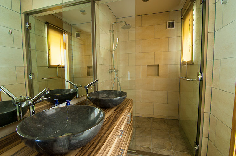 Creekside His and Hers Bathroom with Shower | Annupuri