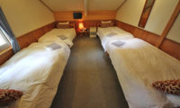 Moorea Lodge Bedroom with Four Beds and Carpet | Middle Hirafu
