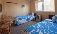 Niseko Auberge de Frying Pan Twin Bedroom with Seating Area | Annupuri