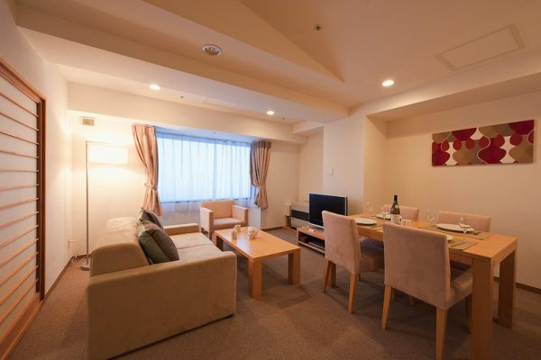 One Niseko Resort Towers Living and Dining Area with TV | Moiwa