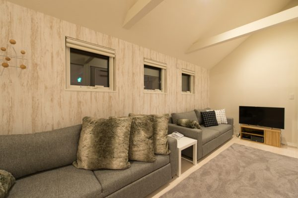 The Orchards Niseko Comfort Lounge Area with TV | West Hirafu