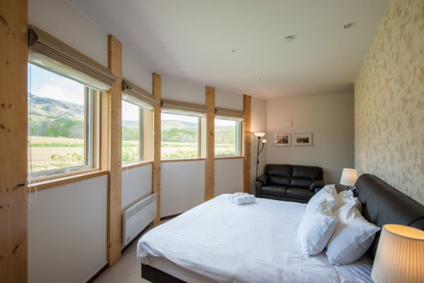 The Orchards Niseko Akagashi Bedroom with Seating Area | West Hirafu