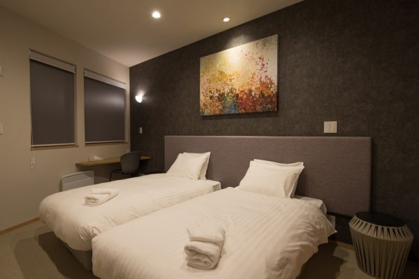 The Orchards Niseko Foxlodge Twin Bedroom at Night | West Hirafu
