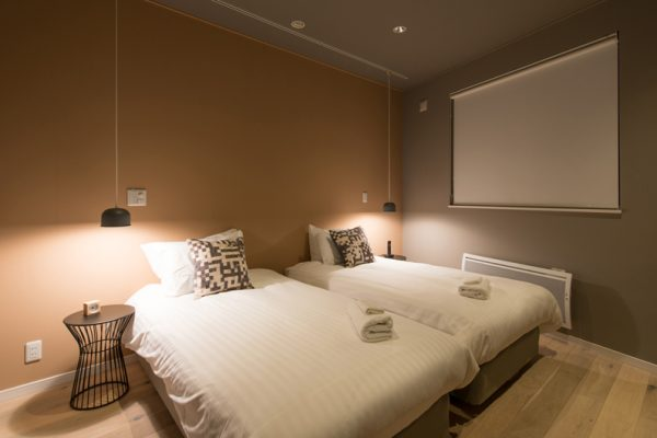 The Orchards Niseko Momiji Twin Bedroom at Night | West Hirafu