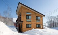Ruby Chalet Exterior with Snow | East Hirafu