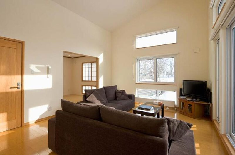 Ruby Chalet Living Area with TV and Wooden Floor | East Hirafu