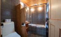 Shin Shin Bathroom with Bathtub and Lamps | Lower Hirafu