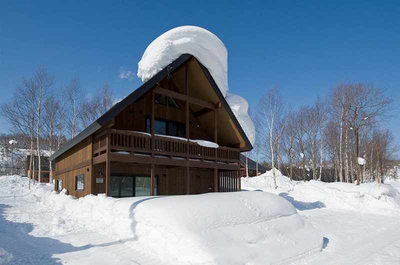 The Chalets at Country Resort Outdoor Area with Snow and Trees | West Hirafu