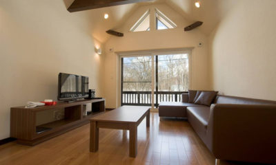 The Chalets at Country Resort Lounge Area with TV and Wooden Floor | West Hirafu