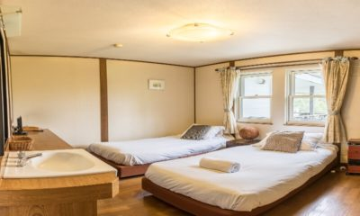 Jam Lodge Niseko Twin Bedroom with Wooden Floor | West Hirafu