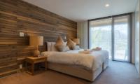 Kawasemi Residence Bedroom with Outdoor View | Lower Hirafu