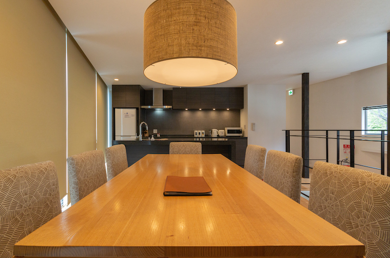 Kawasemi Residence Kitchen and Dining Area with Hanging Light | Lower Hirafu