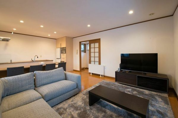 Kiseki Living Area with Wooden Floor and TV | Upper Hirafu
