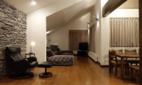 Shungyo Living and Dining Area at Night | East Hirafu