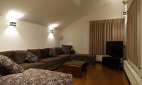 Shungyo Living Area with TV and Wooden Floor | East Hirafu