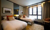 Kasara Townhouses Twin Bedroom with Seating Area | Niseko Village