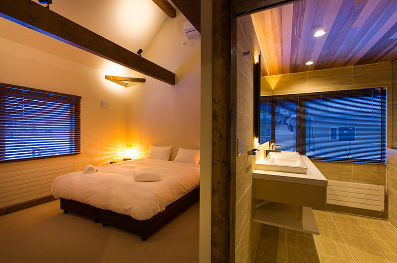 Gresystone Bedroom with Carpet and Table Lamp | Lower Hirafu