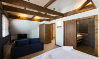 Gresystone Spacious Bedroom with Sofa and TV | Lower Hirafu